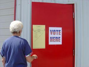 578107_vote_here_woman.jpg